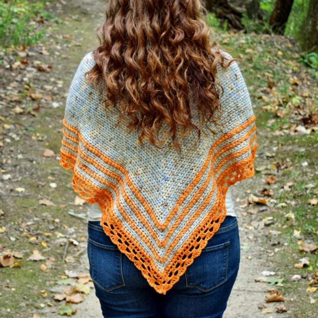 Crochet Triangle Shawl hanging over a woman's shoulders