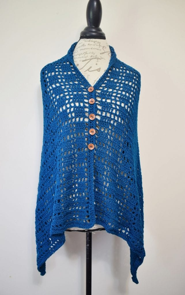 blue crochet wrap poncho displayed on torso