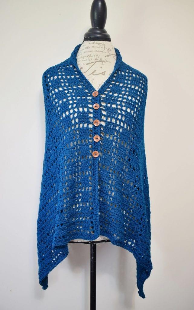 blue crochet wrap poncho displayed on torso