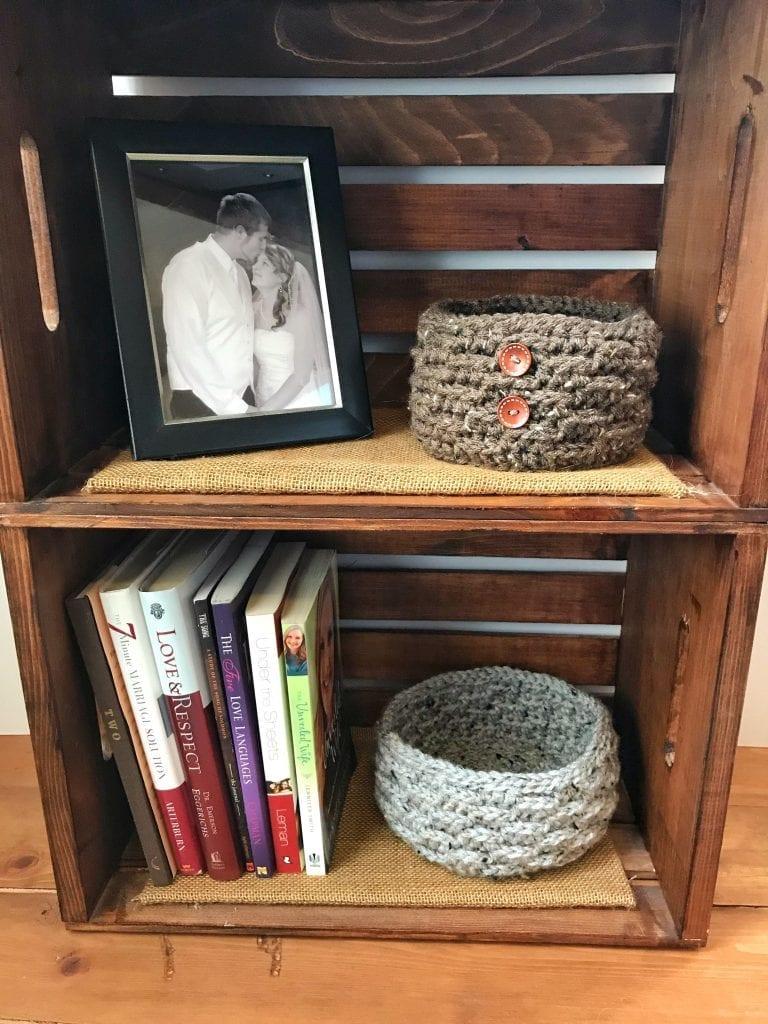 2 crochet baskets on a shelf