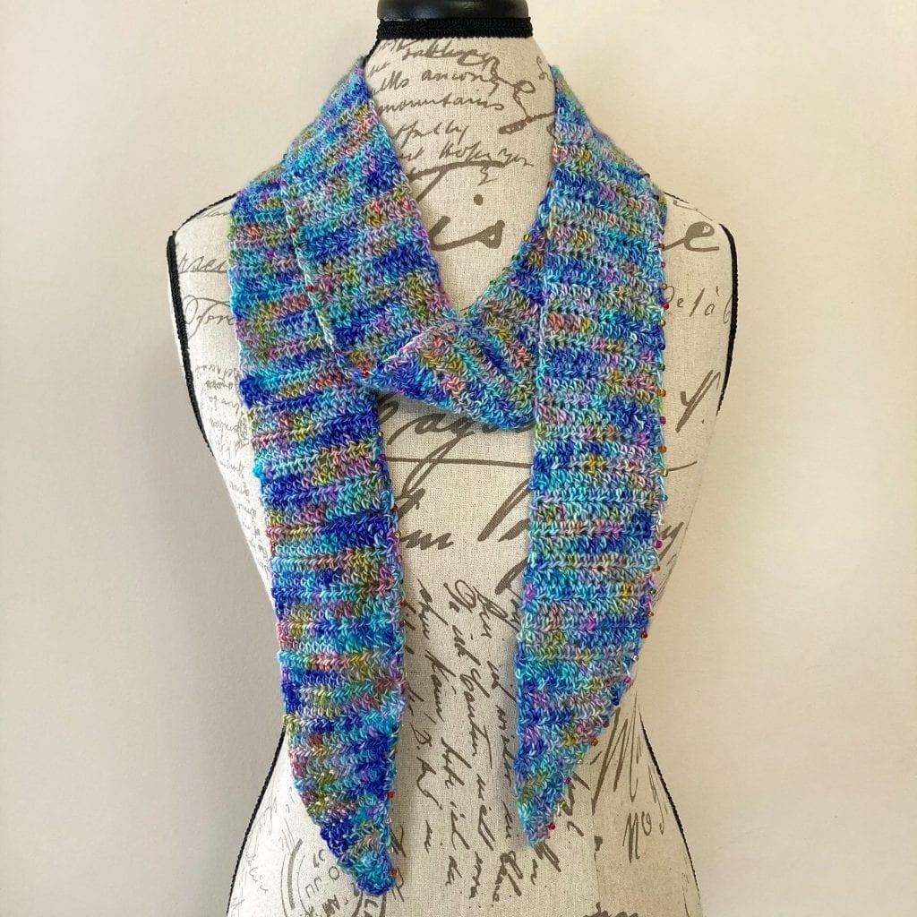 blue skinny crochet scarf displayed