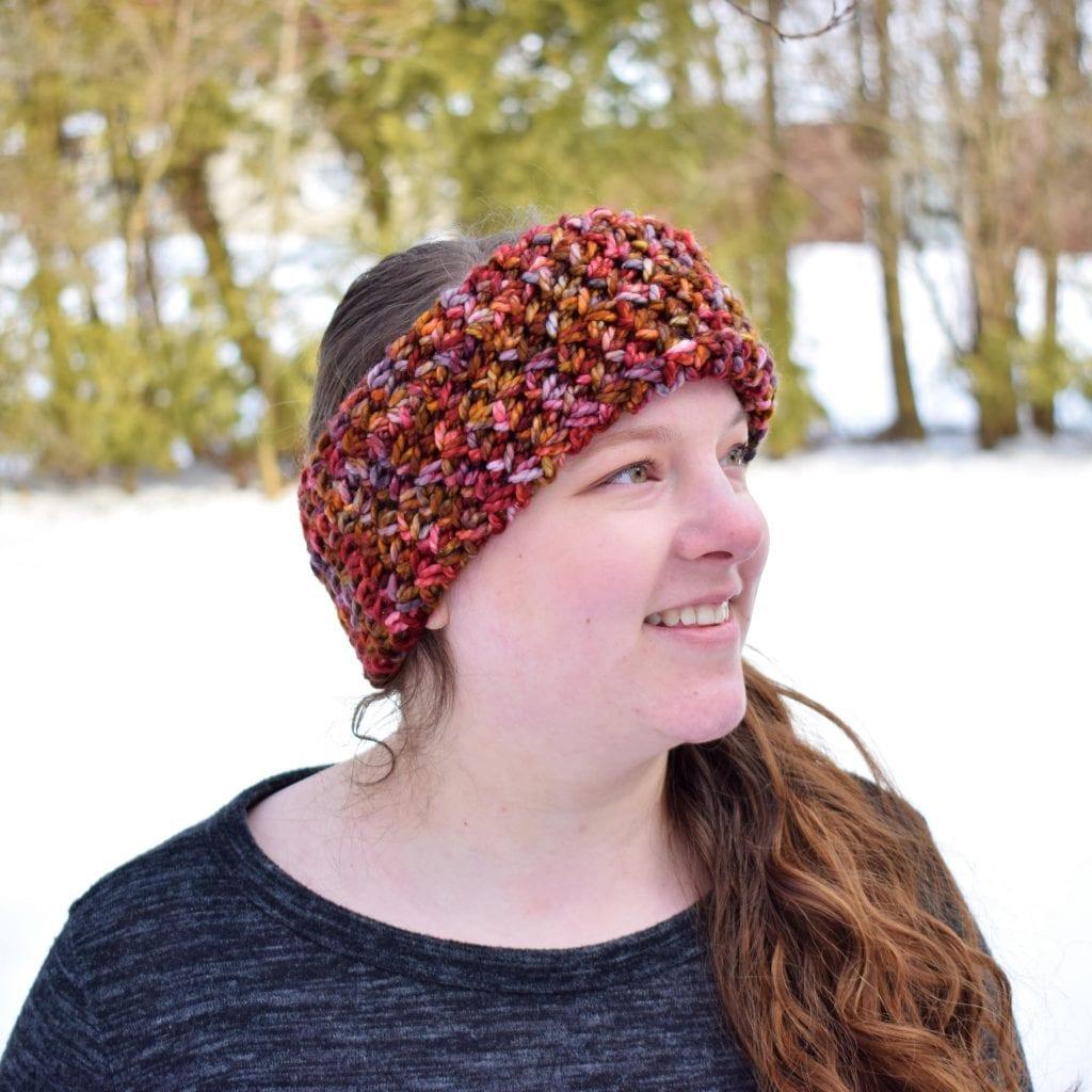 red brown crochet earwarmer on a head