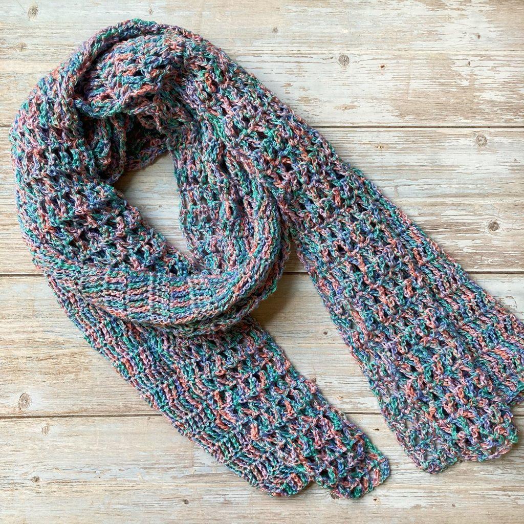 lacy crochet shawl lying flat